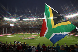 Teams sing the anthems before the start of the Cup Final during the Cup Final match between South Africa and New Zealand on Day 2 of the HSBC Sevens World Series Port Elizabeth Leg held at the Nelson Mandela Bay Stadium on 8th December 2013 in Port Elizabeth, South Africa. Photo by Shaun Roy/Sportzpics