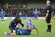 AFC Wimbledon striker Lyle Taylor (33) down injured during the The FA Cup match between AFC Wimbledon and Lincoln City at the Cherry Red Records Stadium, Kingston, England on 4 November 2017. Photo by Matthew Redman.