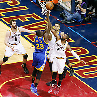 10 June 2016: Cleveland Cavaliers guard Kyrie Irving (2) vies for the rebound with Golden State Warriors forward Draymond Green (23) during the Golden State Warriors 108-97 victory over the Cleveland Cavaliers, during Game Four of the 2016 NBA Finals at the Quicken Loans Arena, Cleveland, Ohio, USA.