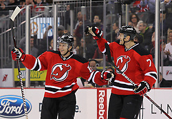 Jan 17; Newark, NJ, USA; New Jersey Devils defenseman Henrik Tallinder (7) and New Jersey Devils right wing Petr Sykora (15) celebrate Sykora's goal during the second period at the Prudential Center.