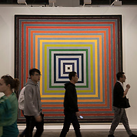 Vistors walk past artist Frank Stella's Lettre sur les sourds et muets I' at Art Basel Hong Kong 2017 on 23 March 2017, in Hong Kong Convention and Exhibition Centre, Hong Kong, China. Photo by Chris Wong / studioEAST