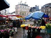 Rennes, FRANCE. Wet  Saturday, Flower Market, Marché des Lices Town hall square Rennes Old quarter, Brittany.<br /> <br /> Saturday  04/04/2009<br /> <br /> [Mandatory Credit;odd-Stock.com ]<br /> NIKON - COOLPIX P6000 - 1/160 - f3.2  5.7MB MB