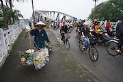 Perfume River (Song Huong), Motorcycles and bicycles on Trang Tien Bridge.