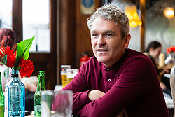 Manchester United fan Andy, 44, visiting London for a Man United v Tottenham Hotspur game discusss Brexit with Bild Reporter Philip Fabian in London. London January 13 2019.