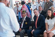 From left, Marc Willard, Rep. Brian Fitzpatrick and Justine Newman of the Chester County Coroner's office attend during burial services with full military honors, held for 12 veterans left unattended by family or friends Thursday, August 29, 2019 at Washington Crossing National Cemetery in Washington Crossing, Pennsylvania. Once a month, burials are held for veterans who have no family and their remains have never been claimed. Some vets remains have waited 12 years for burial. (Photo by William Thomas Cain / CAIN IMAGES)