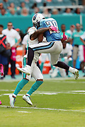 Tennessee Titans running back DeMarco Murray (29) jumps into the arms of Miami Dolphins cornerback Bobby McCain (28) as he gets tackled while running for a fourth quarter gain of 8 yards to the Miami Dolphins 35 yard line during the 2016 NFL week 5 regular season football game against the Miami Dolphins on Sunday, Oct. 9, 2016 in Miami Gardens, Fla. The Titans won the game 30-17. (©Paul Anthony Spinelli)