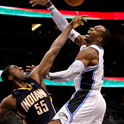 March 11, 2012; Orlando, FL, USA; Indiana Pacers center Roy Hibbert (55) blocks a shot by Orlando Magic center Dwight Howard (12) during the second quarter of a game at  Amway Center.   Mandatory Credit: Derick E. Hingle-USA TODAY SPORTS