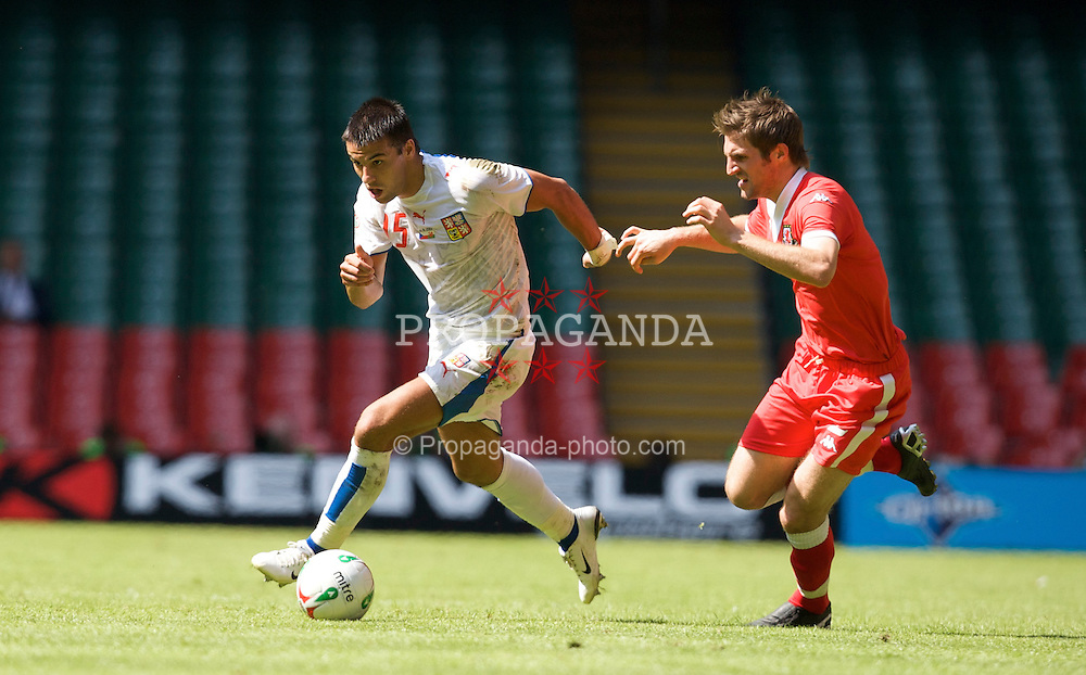 Cardiff, Wales - Saturday, June 2, 2007: Wales' Sam Ricketts and Czech Republic's Milan Baros during the UEFA Euro 2008 Qualifying Group D match at the Millennium Stadium. (Pic by David Rawcliffe/Propaganda)