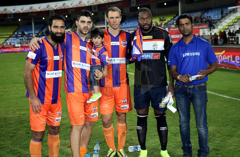 Samsung fan to take samsung galaxy grand prime grouipe during the presentation of the match during match 44 of the Hero Indian Super League between FC Pune City and Atletico de Kolkata FC held at the Shree Shiv Chhatrapati Sports Complex Stadium, Pune, India on the 29th November 2014.<br /> <br /> Photo by:  Sandeep Shetty/ ISL/ SPORTZPICS