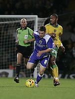 Photo: Barry Bland.<br />Norwich City v Cardiff City. Coca Cola Championship.<br />01/11/2005.<br />Jurgen Colin and Jason Koumas.