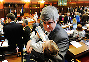 State Rep. Tim O'Brien, of New Britain, feeds his 11-month old daughter Olivia on the house floor prior to Connecticut Governor Dannel P. Malloy's budget address to a joint session of the state General Assembly Wednesday, February 16, 2011. Malloy is proposing to close a projected $3.7 billion gap by a combination of spending cuts, concessions from state employee labor unions and tax increases. (Sean D. Elliot/The Day)
