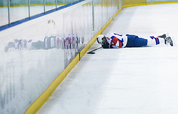 Injured ROK LEBER of Slovenia during Friendly Ice-hockey match between National teams of Slovenia and Italy on April 5, 2013 in Ice Arena Tabor, Maribor, Slovenia. Slovenia defeated Italy 5-3 after penalty shots. (Photo By Vid Ponikvar / Sportida)