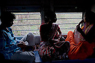 (L-R).Rajendra Lakhera, Rani Lakhera (sister of Rajendra) and Sulochna Lakhera (wife of Rajendra) aged 32, chat with each other as they pass from Madhya Pradesh to Maharastra on 8th July 2009...Train passengers on the Himsagar Express 6318 going from Jammu Tawi station to Kanyakumari on 8th July 2009.. .6318 / Himsagar Express, India's longest single train journey, spanning 3720 kms, going from the mountains (Hima) to the seas (Sagar), from Jammu and Kashmir state of the Indian Himalayas to Kanyakumari, which is the southern most tip of India...Photo by Suzanne Lee / for The National