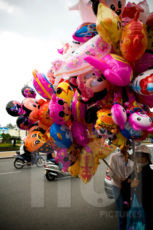 Street vendors selling balloons in a street of Ho Chi Minh city, Vietnam, Southeast Asia