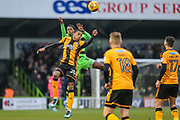 Forest Green Rovers Farrend Rawson(20) and Cambridge United's Jevani Brown(20) jump for the ball during the EFL Sky Bet League 2 match between Forest Green Rovers and Cambridge United at the New Lawn, Forest Green, United Kingdom on 20 January 2018. Photo by Shane Healey.