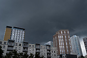 Dark skies gather over the rooftops of new apartment towers in the East London area of Aldgate, on 17th August 2020, in London, England.