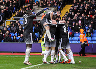 Willian of Chelsea scores a screamer to make it 0-2 and celebrates with teammates during the Barclays Premier League match between Crystal Palace and Chelsea at Selhurst Park, London, England on 3 January 2016. Photo by Ken Sparks.