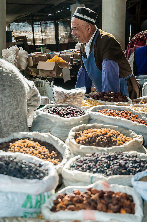 Portrait of an old Tajik man selling raisins in a market in western Tajikistan