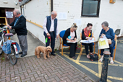 © Licensed to London News Pictures. 01/08/2019. Llandrindod Wells, Powys, UK. People arrive at the Pavilion polling station in Llandrindod Wells in Powys, to vote in the Brecon & Radnorshire by-election. The by-election has been recalled because the incumbent Tory MP. Chris Davies, who has been convicted for faking expenses claims, has been booted from the seat after a recall petition was passed when more than 10,000 voters backed the move. Photo credit: Graham M. Lawrence/LNP