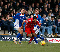 Jack Lester of Nottingham Forest (centre) bursts through the Chesterfield defence