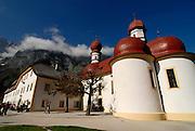 The very famous St. Bartholomä church on the  Königssee in the background the Watzman, Berchtesgadener land National park, Bavaria, Germany