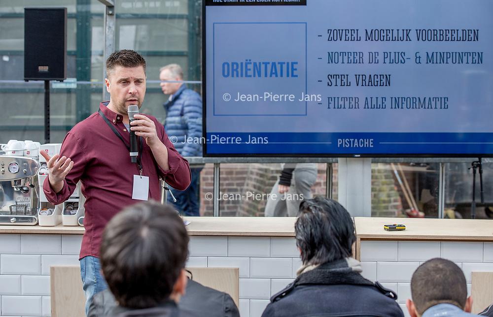 Nederland, Amsterdam, 10 maart 2017.<br />De stand van Illy tijdens de Amsterdam Coffee Festival in de Gashouder op het Westergasfabriek terrein.<br />Op de foto: Hylke Thiry (Pistache) tijdens zijn workshop Hoqw to star a Coffee Bar.<br /><br /><br /><br />Foto: Jean-Pierre Jans