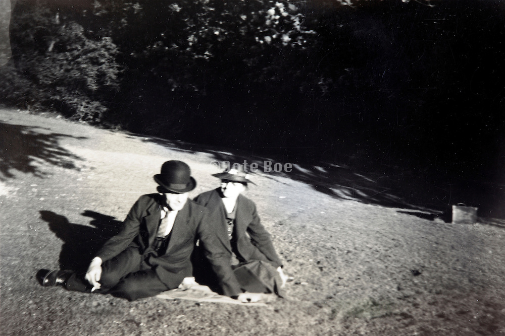 elderly couple sitting outdoors England 1900s