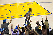 Fans celebrate a basket by Golden State Warriors forward Kevin Durant (35) during a NBA game against the Dallas Mavericks at Oracle Arena in Oakland, California, on February 8, 2018. (Stan Olszewski/Special to S.F. Examiner)