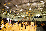 Students toss their hats during the 47th commencement excercise of Archbishop Alter High School at Trent Arena in Kettering, Saturday, May 26, 2012.