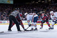 KELOWNA, CANADA - MARCH 10: Erik Gardiner #12 of the Kelowna Rockets faces off against Nick Chyzowski #16 of the Kamloops Blazers  on March 10, 2018 at Prospera Place in Kelowna, British Columbia, Canada.  (Photo by Marissa Baecker/Shoot the Breeze)  *** Local Caption ***