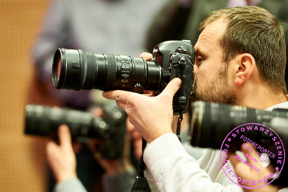 Photographer Bartlomiej Zborowski works during press conference of Polish Tennis Association before Fed Cup match at National Stadium in Warsaw, Poland.<br /> <br /> Poland, Warsaw, December 15, 2014<br /> <br /> Picture also available in RAW (NEF) or TIFF format on special request.<br /> <br /> For editorial use only. Any commercial or promotional use requires permission.<br /> <br /> Mandatory credit:<br /> Photo by &copy; Adam Nurkiewicz / Mediasport