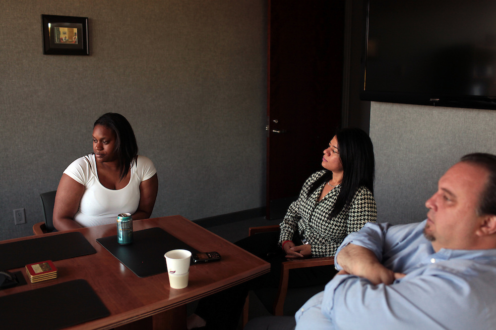 From left, Target employee Tashawna Green, Aly Waddy and Patrick Purcell, Spokesman for UFCW 1500 at their office in Garden City, NY on June 2, 2011.