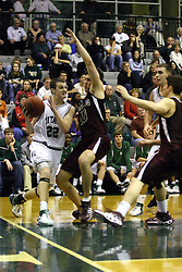 16 December 2006: Andrew Gilmore cuts hard at the baseline and is fouled by Adam Machones. The University of Chicago Maroons upset  the Illinois Wesleyan Titans 64 - 60 at the Shirk Center in Bloomington Illinois.<br />