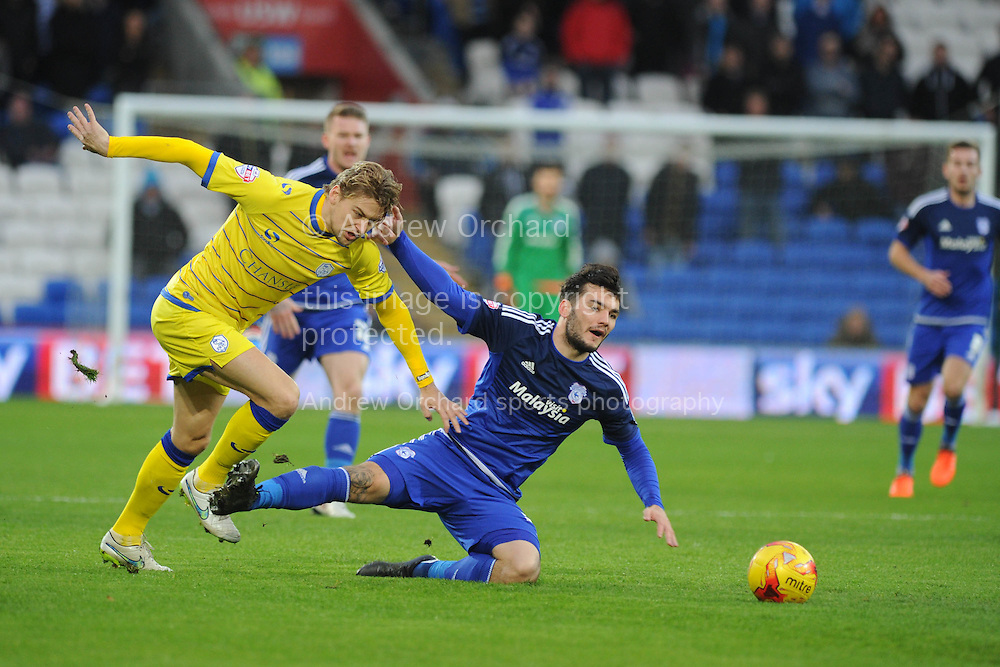 Glen Loovens of Sheffield Wed fouls Tony Watt of Cardiff city &reg;. Skybet football league championship match, Cardiff city v Sheffield Wednesday at the Cardiff city stadium in Cardiff, South Wales on Saturday 12th December 2015.<br /> pic by Andrew Orchard, Andrew Orchard sports photography.