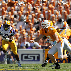 Oct 2, 2010; Baton Rouge, LA, USA; LSU Tigers defensive end Lavar Edwards (89) and Tennessee Volunteers quarterback Matt Simms (2) chase after a loose ball during the first half at Tiger Stadium.  Mandatory Credit: Derick E. Hingle