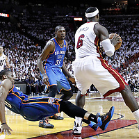 19 June 2012: Miami Heat small forward LeBron James (6) posts up Oklahoma City Thunder point guard Russell Westbrook (0) who fells during the Miami Heat 104-98 victory over the Oklahoma City Thunder, in Game 4 of the 2012 NBA Finals, at the AmericanAirlinesArena, Miami, Florida, USA.