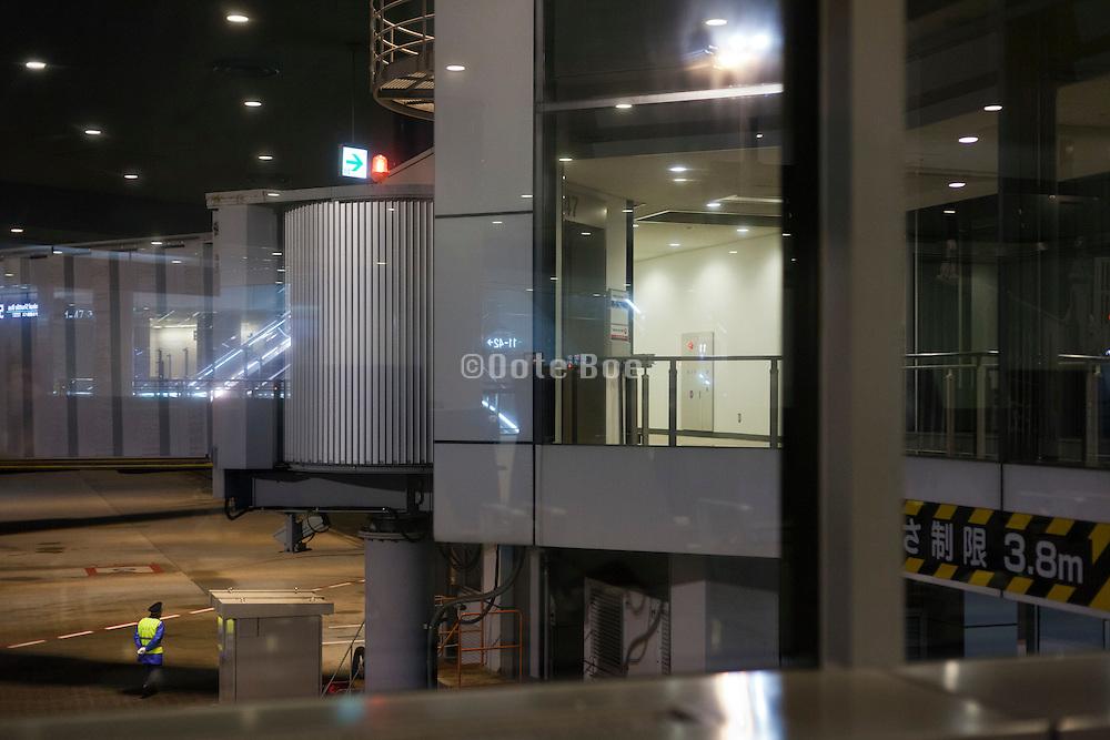 tarmac security guard walking during night Narita airport Tokyo Japan
