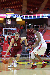 26 November 2016:  Matt O'Leary brings the ball to the 3 point arc guarded by Deontae Hawkins(23) during an NCAA  mens basketball game between the IUPUI Jaguars the Illinois State Redbirds in a non-conference game at Redbird Arena, Normal IL