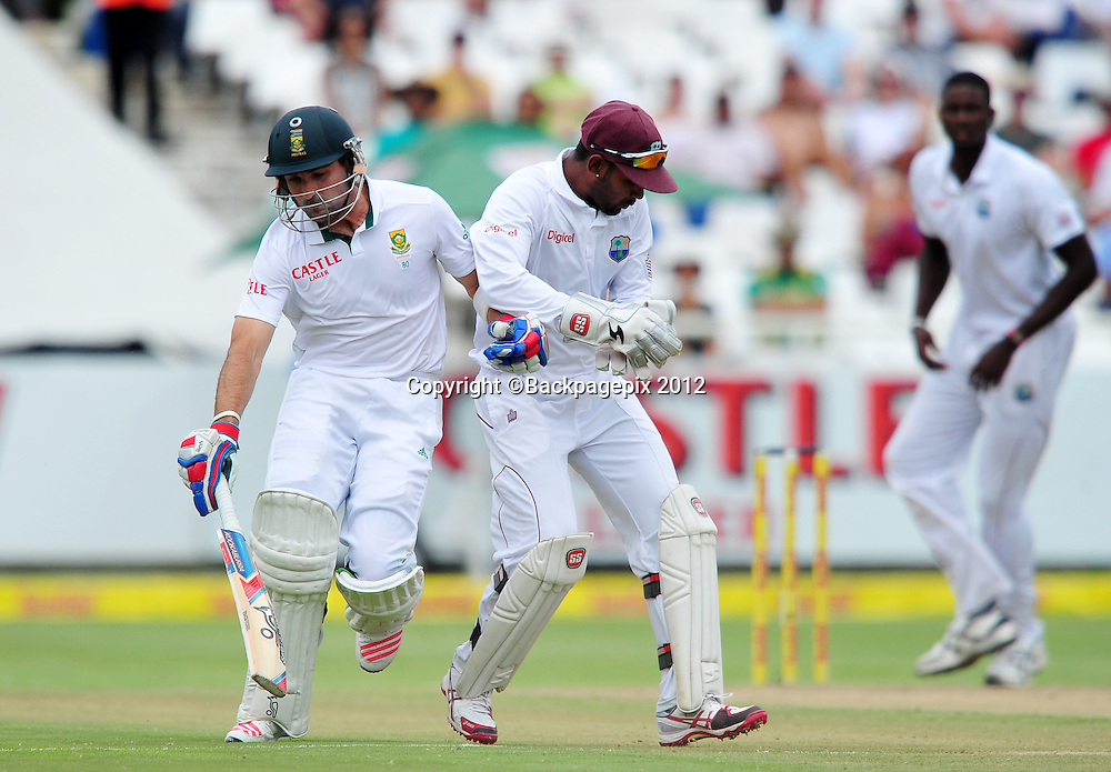 Dean Elgar of South Africa collides with West Indian wicketkeeper Denesh Ramdin during day 2 of the Sunfoil Test Series 2014/15 game between South Africa and the West Indies at Newlands Stadium, Cape Town on 3 January 2015 ©Ryan Wilkisky/BackpagePix