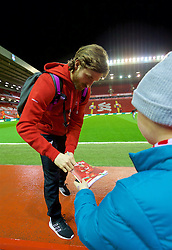 LIVERPOOL, ENGLAND - Wednesday, March 2, 2016: Liverpool's Joe Allen signs an autograph as he arrives before the Premier League match against Manchester City at Anfield. (Pic by David Rawcliffe/Propaganda)