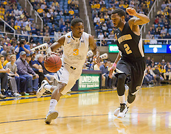 West Virginia Mountaineers guard Juwan Staten (3) drives to the basket against the Wofford terriers during the first half at the WVU Coliseum.