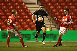 Rotherham's Daniel Lafferty controls under pressure from Nottingham Forest's Henri Lansbury and Nottingham Forest's Chris Burke - Photo mandatory by-line: Robbie Stephenson/JMP - Mobile: 07966 386802 - 18/03/2015 - SPORT - Football - Nottingham - City Ground - Nottingham Forest v Rotherham United - Sky Bet Championship