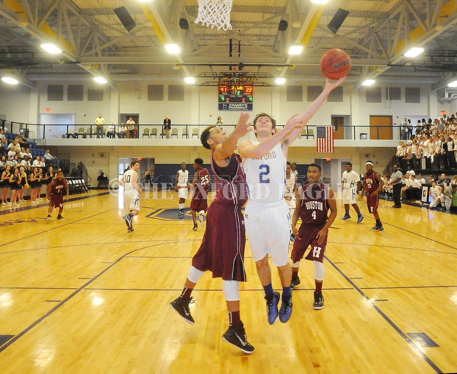 Oxford High's Josh Gibbs (2) shoots against Houston's Caleb Morgan (24) in Oxford, Miss. on Thursday, November 20, 2014.