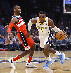 October 23, 2017 - Denver, Colorado, U.S - Nuggets PAUL MILLSAP, right, runs to the paint with Wizards, JOHN WALL, left, during the 1st. Half at the Pepsi Center Monday night. The Nuggets lose to the Wizards 109-104  (Credit Image: © Hector Acevedo via ZUMA Wire)