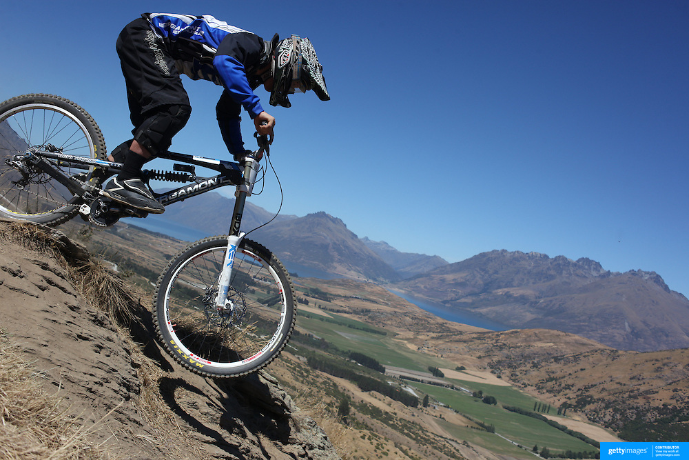 Rupert Chapman from Christchurch  in action during the New Zealand South Island Downhill Cup Mountain Bike series held on The Remarkables face with a stunning backdrop of the Wakatipu Basin. 150 riders took part in the two day event. Queenstown, Otago, New Zealand. 9th January 2012. Photo Tim Clayton