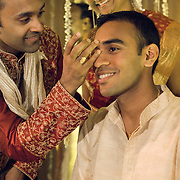 Applying tikka put on a South Indian Groom during a Tamil Brahmin Wedding