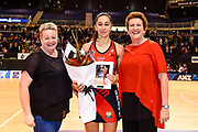 Samon Nathan of the Tactix receives a gift on getting to 50 matches from Jen Hooper ((L) Tactix Performance Manager) and Brigit Hearn ((R)Tactix CEO) during the ANZ Premiership Netball match, Tactix v Steel, Horncastle Arena, Christchurch, New Zealand, 15th May 2019.Copyright photo: John Davidson / www.photosport.nz