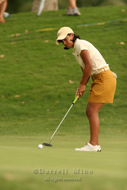 Feb 25, 2006; Kapolei, HI, USA;  Julieta Granada watches her putt during the final round at the inaugural LPGA Fields Open at Ko Olina Resort. ..Photo Credit: Darrell Miho .Copyright © 2006 Darrell Miho