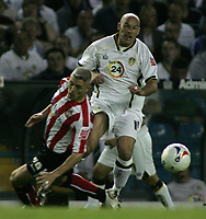 Photo: Paul Thomas.<br /> Leeds United v Sunderland. Coca Cola Championship. 13/09/2006.<br /> <br /> Steve Stone of Leeds (R) gets tackled by Graham Kavanagh.