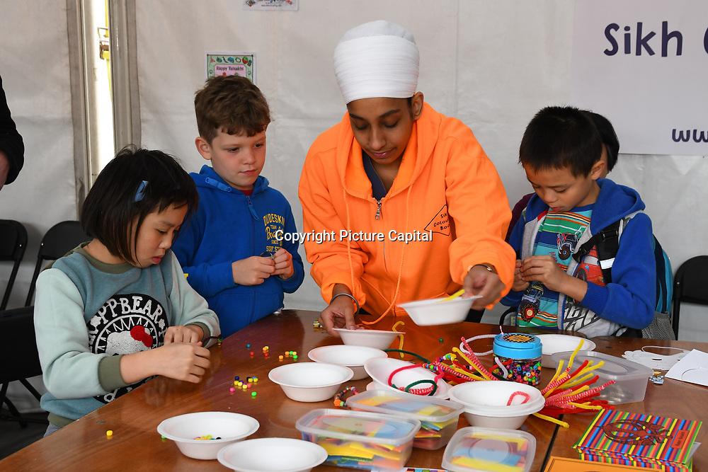 London, England, UK. 27 April 2019. Sikh Colouring Books   Sikh Kids Activities stall at the Vaisakhi Festival is a Sikh New Year in Trafalgar Square, London, UK.